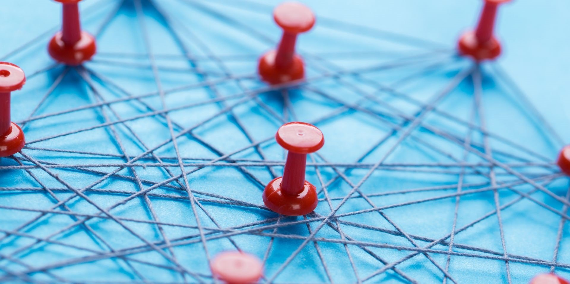 Close-up of the pins connected to each other by a string