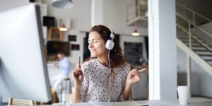 A happy woman listening to music